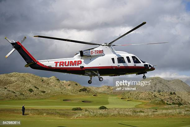 Presumptive Republican nominee for US president Donald Trump arrives in a helicopter at Trump International Golf Links on June 25 2016 in Aberdeen...