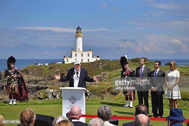 Presumptive Republican nominee for US president Donald Trump gives press conference on the 9th tee at his Trump Turnberry Resort surrounded by his...