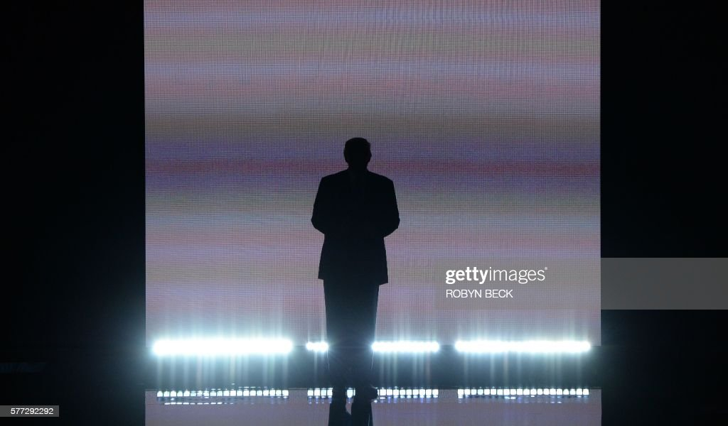 TOPSHOT - Presumptive Republican presidential candidate Donald Trump arrives on stage on the first day of the Republican National Convention on July 18, 2016 at Quicken Loans Arena in Cleveland, Ohio. The Republican Party opened its national convention, kicking off a four-day political jamboree that will anoint billionaire Donald Trump as its presidential nominee. / AFP / Robyn BECK