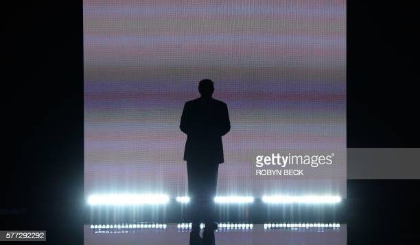TOPSHOT Presumptive Republican presidential candidate Donald Trump arrives on stage on the first day of the Republican National Convention on July 18...