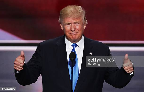 Presumptive Republican presidential nominee Donald Trump gives thumbs up while introducing his wife Melania on the first day of the Republican...