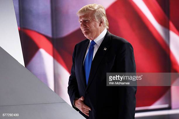 Presumptive Republican presidential nominee Donald Trump walks on stage to introduce his wife Melania on the first day of the Republican National...