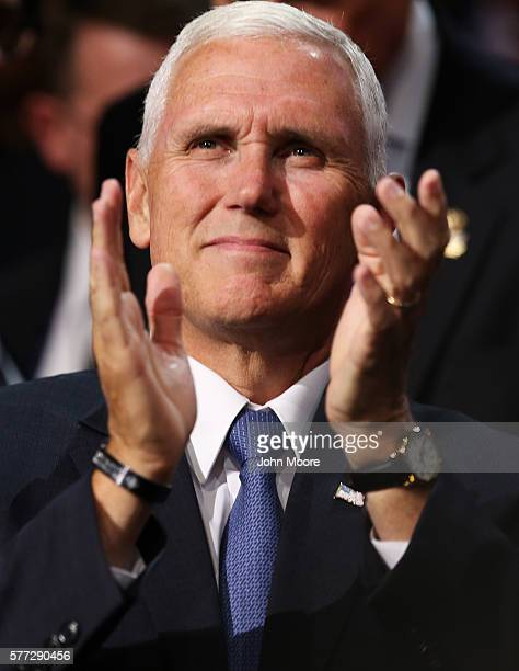 Presumptive Republican Vice Presidential candidate Indiana Gov Mike Pence claps while listening to a speech on the first day of the Republican...
