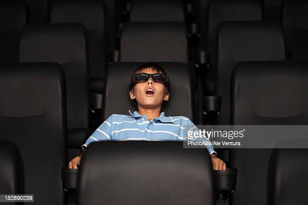 preteen boy watching 3-d movie in theater - redoubtable film stock photos and pictures