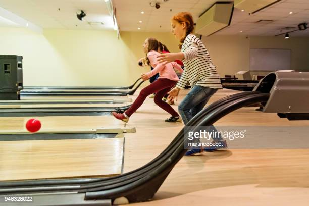 "preteen girl and friends playing bowling. - ""martine doucet"" or martinedoucet stock pictures, royalty-free photos & images"
