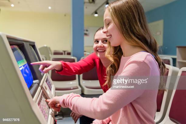 Preteen girl keeping scores of bowling game.