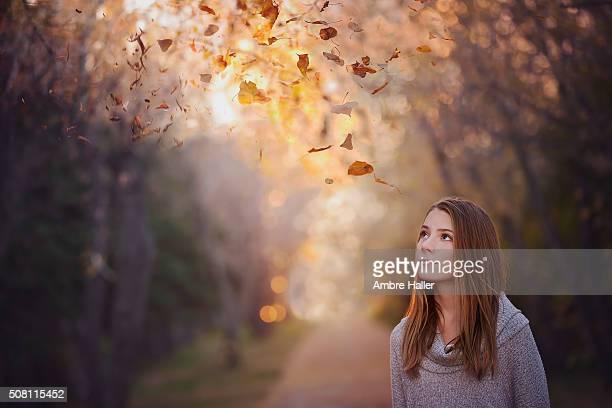 pre-teen girl looking up watching leaves fall - pre season bildbanksfoton och bilder