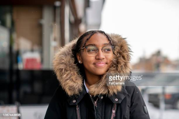 preteen girl outside in the city in the winter - refugee stock pictures, royalty-free photos & images