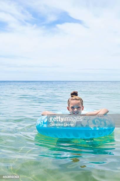 pre-teen girl playing in ocean