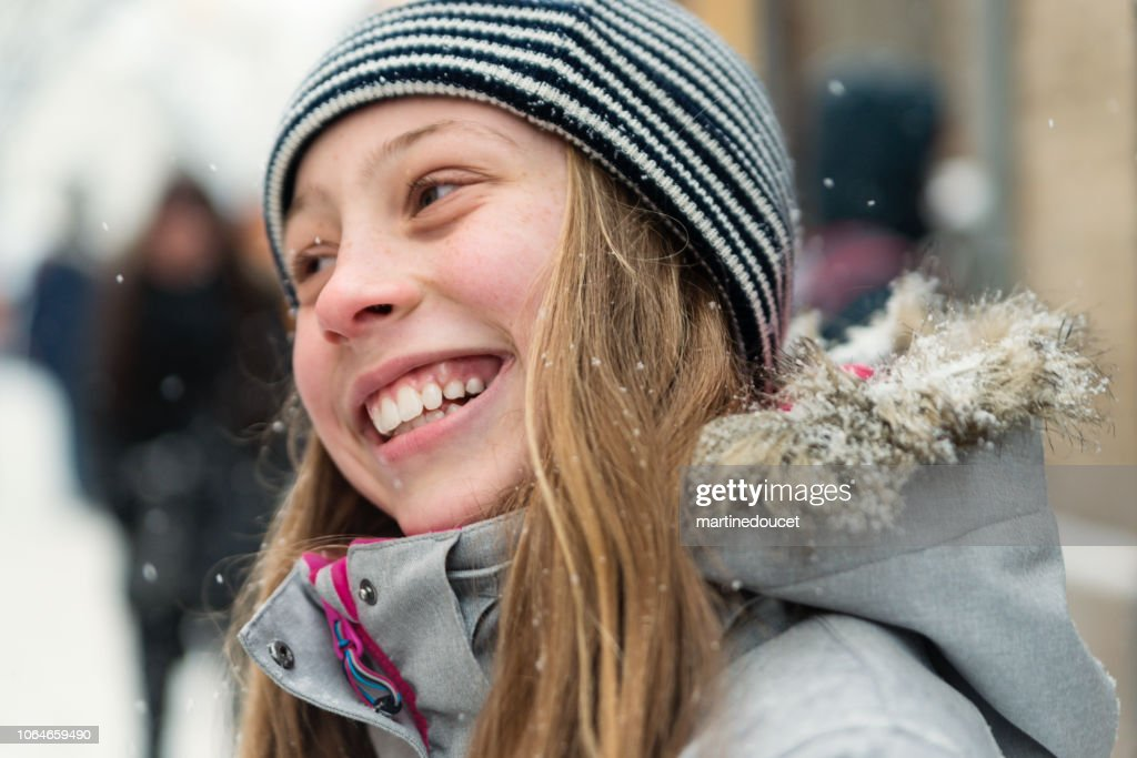 Preteen girl portrait outdoors on city street in winter. : Stock Photo