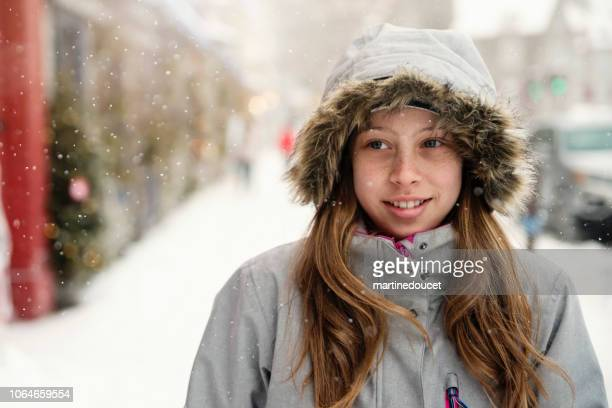 """preteen girl portrait outdoors on city street in winter. - """"martine doucet"""" or martinedoucet stock pictures, royalty-free photos & images"""