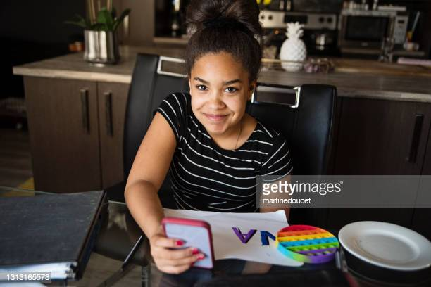 """preteen girl taking a break from homeschooling. - """"martine doucet"""" or martinedoucet stock pictures, royalty-free photos & images"""