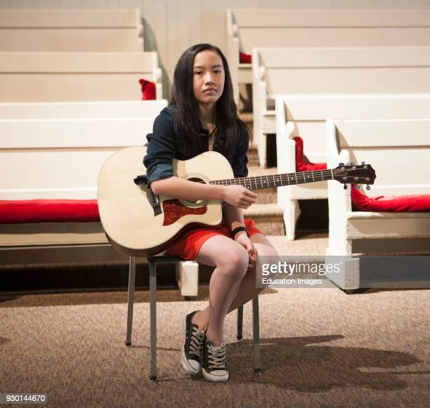 PreTeen Girl With Guitar Portrait