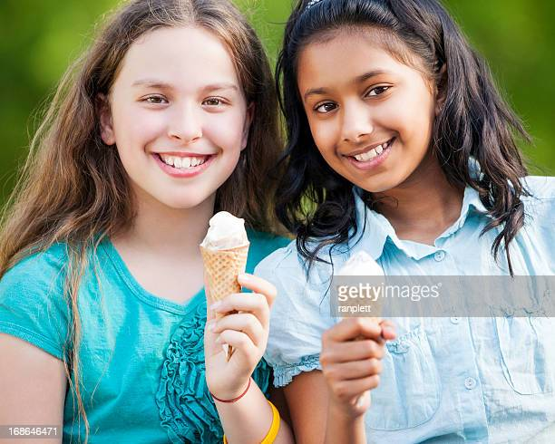Pre-teen Girls Eating Ice Cream