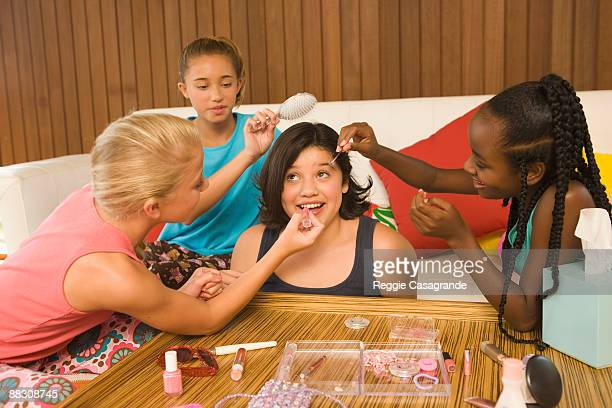 Pre-teen girls giving makeover