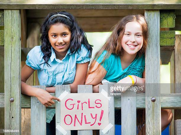 Pre-Teen Girls Hanging Out in Their Clubhouse