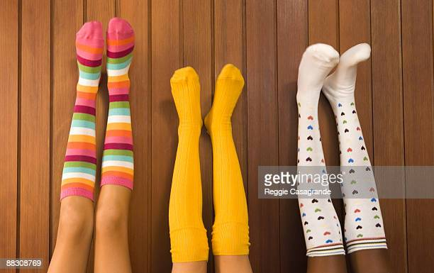 pre-teen girls wearing colorful socks - kneesock stock pictures, royalty-free photos & images