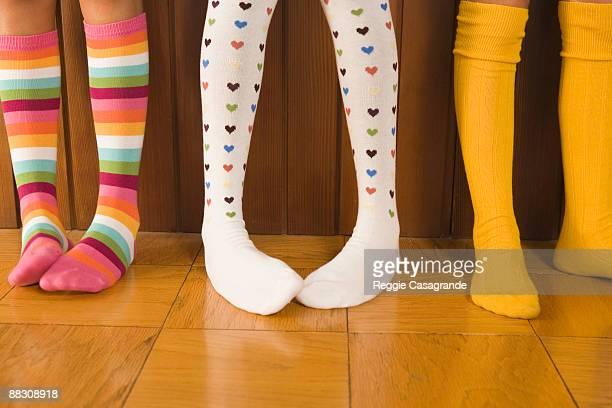 pre-teen girls wearing colorful socks - ハイソックス ストックフォトと画像