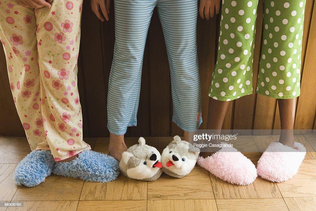 Pre-teen girls wearing fuzzy slippers : Stock Photo