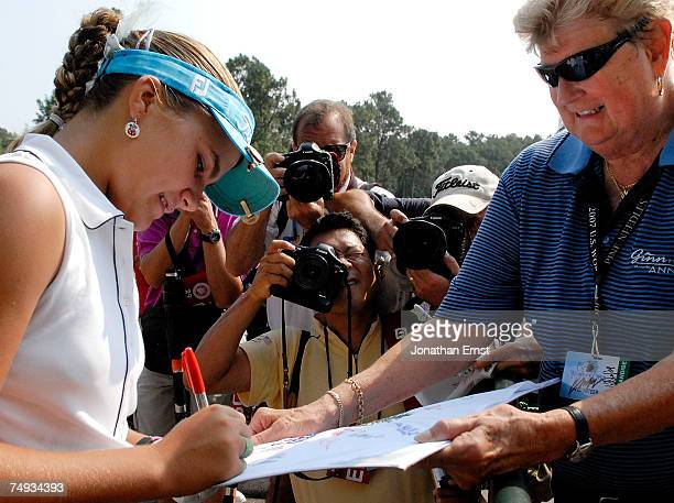 Preteen golfer Alexis Thompson signs autographs after a practice round prior to the start of the US Women's Open Championship at Pine Needles Lodge...