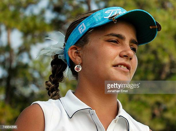 Preteen golfer Alexis Thompson walks from the 18th green after a practice round prior to the start of the US Women's Open Championship at Pine...