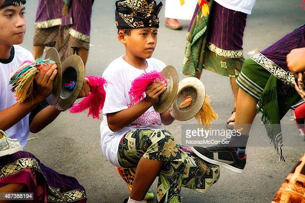 pre-teen indonesian boy playing cymbals during  ngrupuk parade - balinese culture stock pictures, royalty-free photos & images