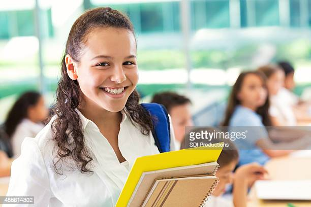 Preteen private junior high school student smiling in classroom