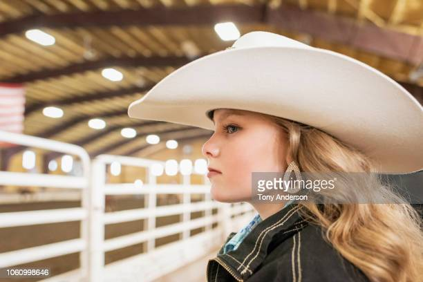 pre-teenage girl in cowboy hat watching rodeo - beauty contest stock pictures, royalty-free photos & images