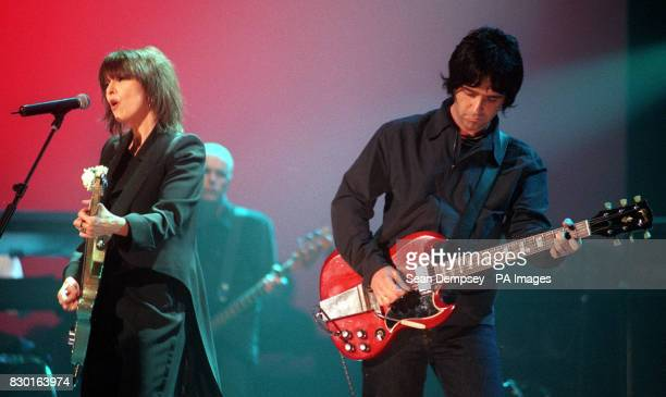 Pretenders singer Chrisse Hynde with former Smiths guitarist Johnny Marr perform during 'Here There and Everywhere' a charity concert at the Royal...