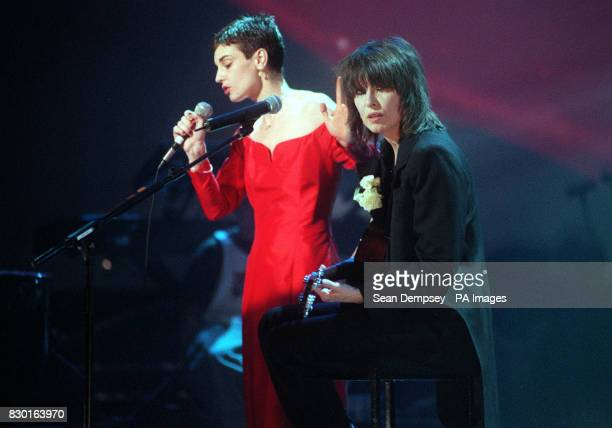 Pretenders singer Chrisse Hynde with Irish singer Sinead O'Connor perform during 'Here There and Everywhere' a charity concert at the Royal Albert...