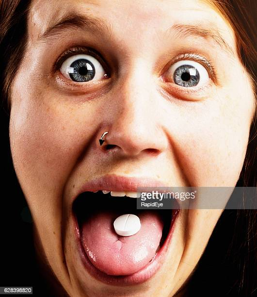 pretty and very excited girl showing pill on her tongue - lsd stock pictures, royalty-free photos & images