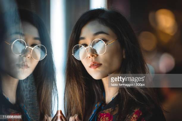 pretty asian woman portrait with led lights - 後ろで束ねた髪 ストックフォトと画像