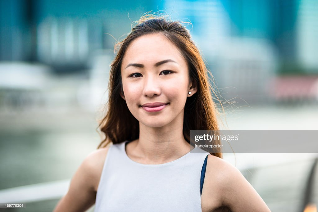 pretty asian woman standing outdoors : Stock Photo