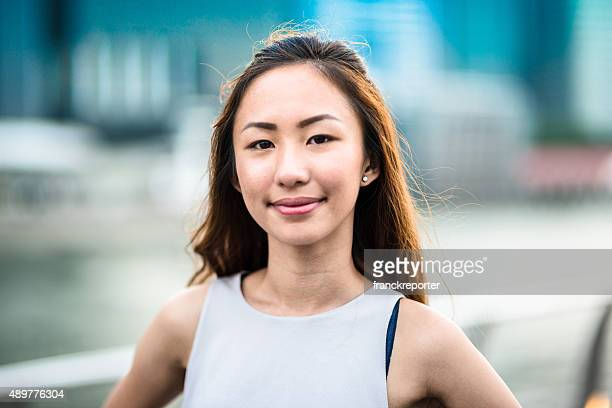 pretty asian woman standing outdoors - 20 24 years stock pictures, royalty-free photos & images