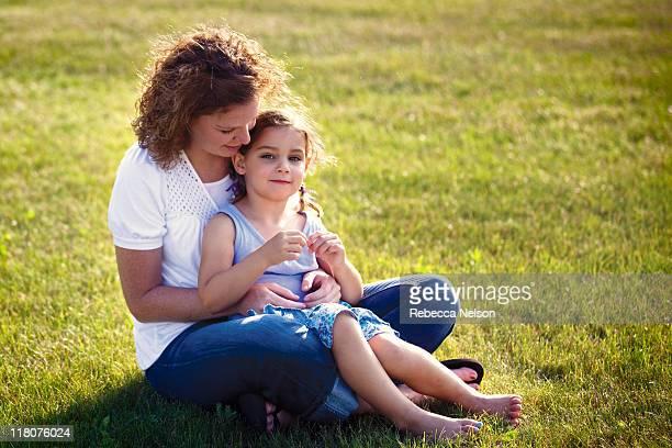 pretty aunt with niece sitting on her lap - niece - fotografias e filmes do acervo