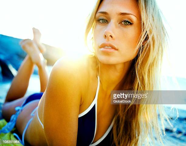 pretty blond female lying on beach in bikini - beautiful beach babes stock pictures, royalty-free photos & images