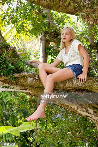 Pretty Blonde Girl in a Banyon Tree