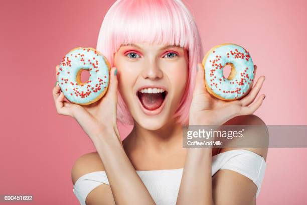 Pretty blonde with multi-colored donuts