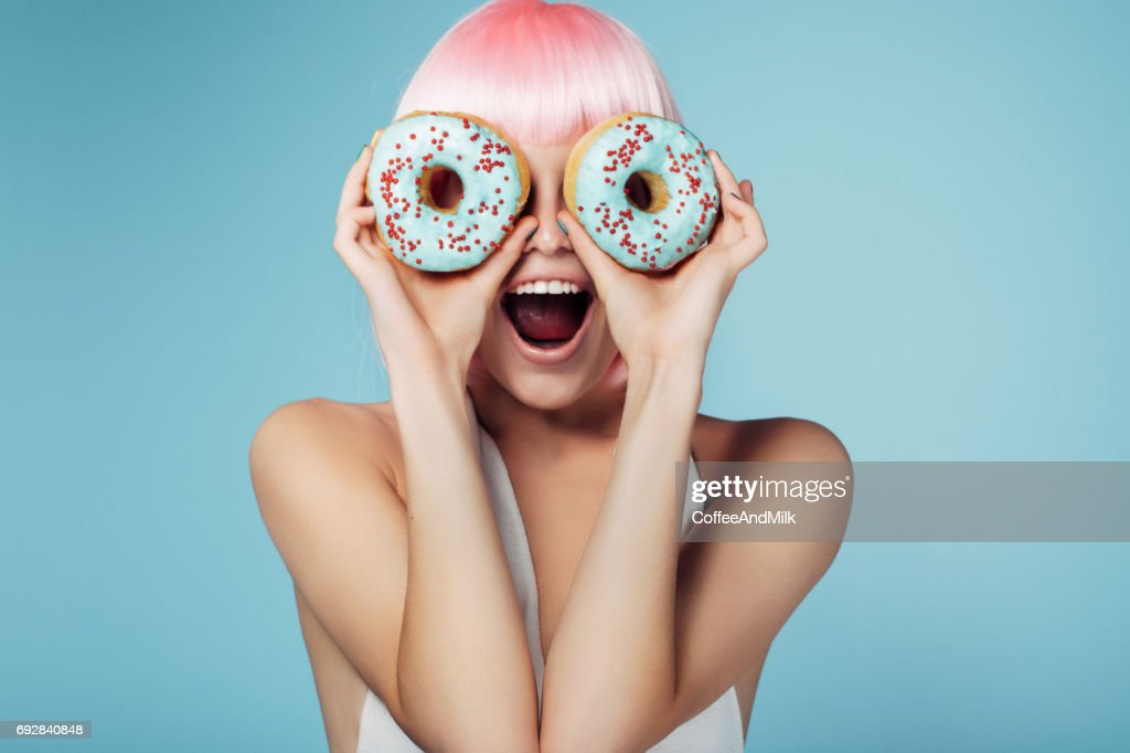 Pretty blonde with multi-colored donuts : Stock Photo