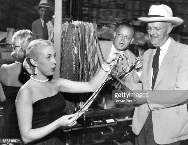 INVASION — Pretty Bonnie Ann Shaw who whistles and sings with Ted Weems' band at Elitch Gardens pipes up a tune while she is absorbed in making a...