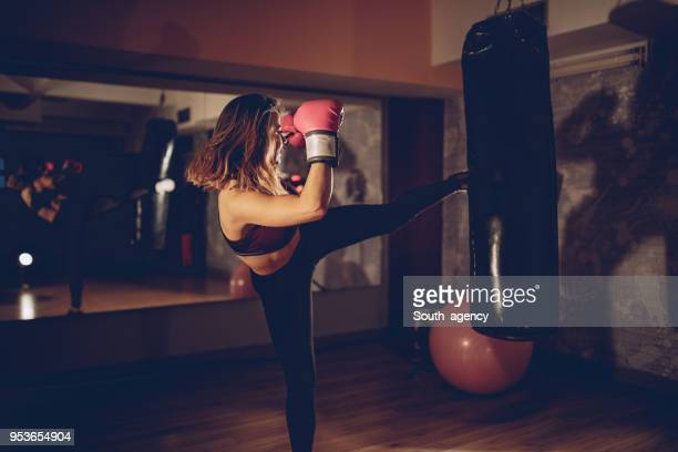 pretty boxer in the gym - kickboxing stock pictures, royalty-free photos & images