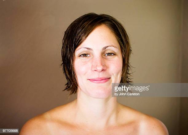 Pretty brunette woman with bare shoulders