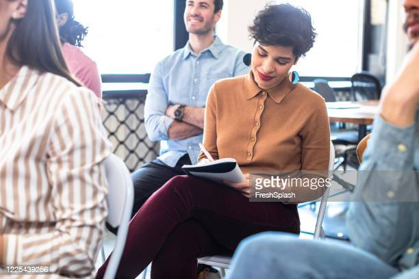 pretty businesswoman taking notes at business training - attending stock pictures, royalty-free photos & images