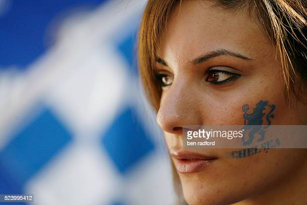 A pretty Chelsea fan with the club crest on her cheek during the FA Cup Semi Final match between Arsenal and Chelsea at Wembley Stadium in London UK