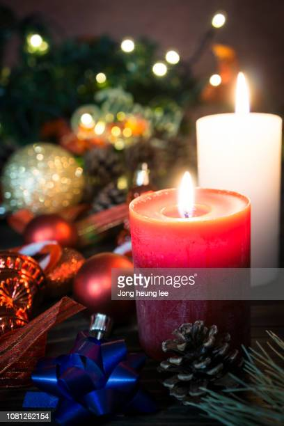 pretty christmas light decoration with candle - jong heung lee stock pictures, royalty-free photos & images