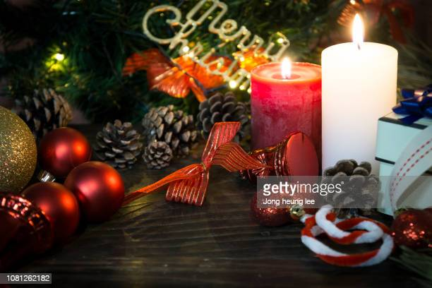 Pretty Christmas light decoration with candle