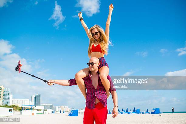 Pretty Couple using selfie stick, Miami Beach
