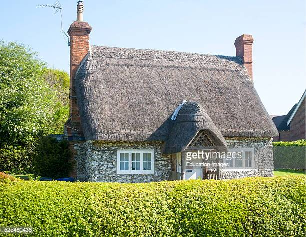 Pretty detached thatch and flint cottage Wilcot village Wiltshire England