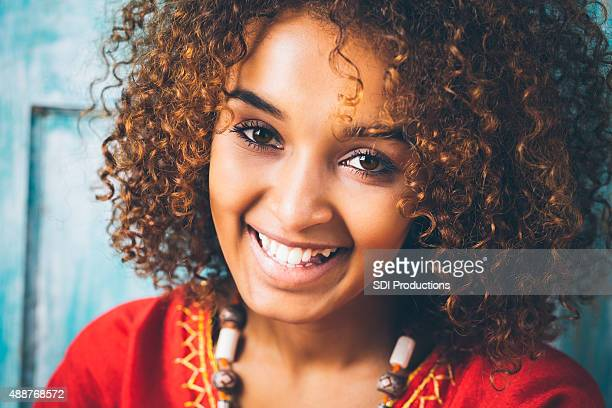 pretty ethiopian girl smiling while wearing traditional clothing - beautiful ethiopian girls stock photos and pictures