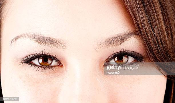 pretty eyes of asian teen - light brown eyes stock photos and pictures